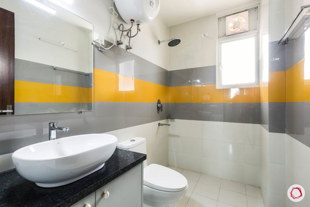 bathroom-yellow-grey-tiles-white-sink