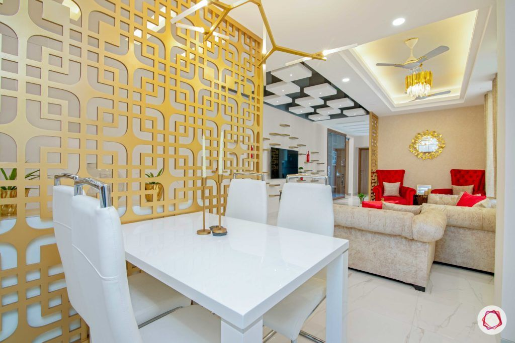 tdi ourania_dining room_white dining table_gold jaali divider