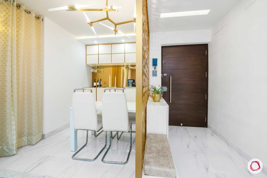 tdi ourania_dining room_white wall_white chairs_white table
