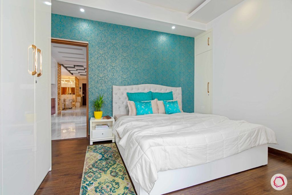 tdi ourania_guest bedroom_blue wallpaper_white bed