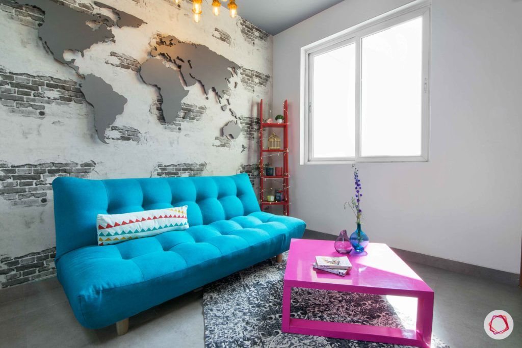 beautiful house design-blue sofa-world map wall-pink coffee table