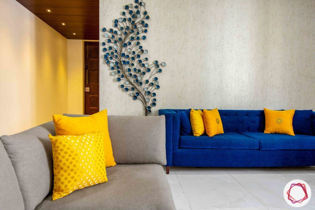 Vastu tips for home-living room-blue sofa-blue accessories