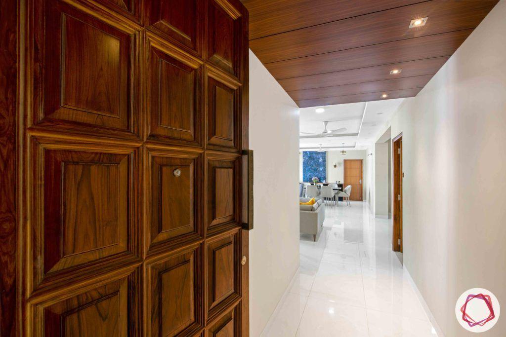 Shipra Srishti-entrance-door-wooden-spotlights