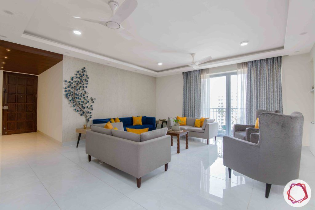 Shipra Srishti-living-room-blue-yellow-sofa-pillows-floral-accent-grey