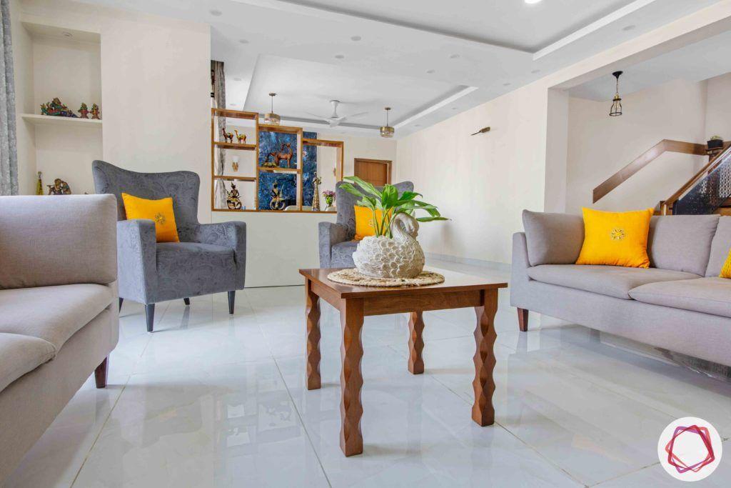 Shipra Srishti-living-room-blue-yellow-sofa-pillows-floral-accent-coffee-table