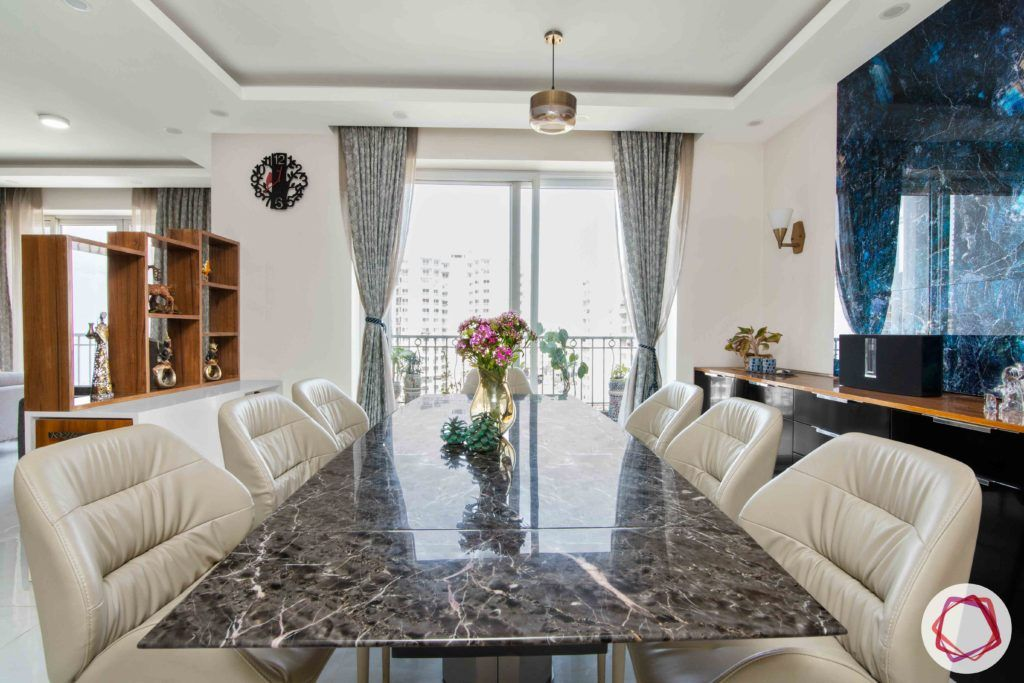 Shipra Srishti-dining-table-chairs-curtain-stone-tile-work