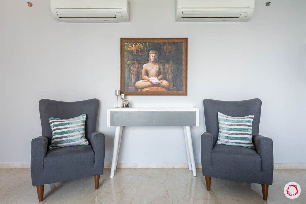 oberoi goregaon-console table-grey chairs-buddha painting
