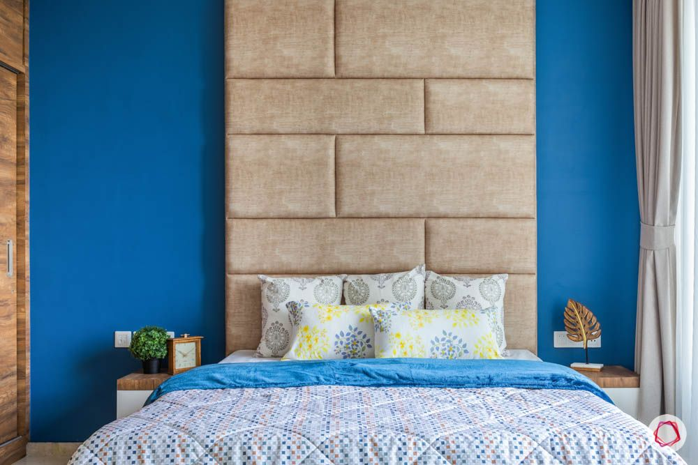 oberoi goregaon-master bedroom-blue wall-suede headboard