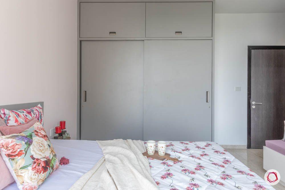 oberoi goregaon-pastel bedroom-grey wardrobe-sliding door wardrobe