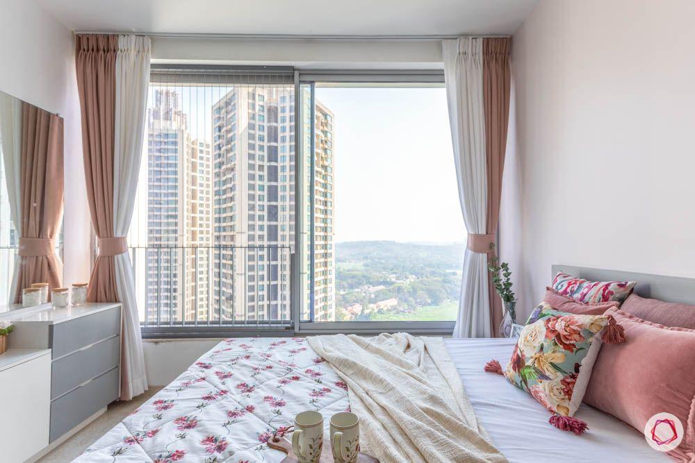 oberoi goregaon-pastel bedroom-big window-dresser