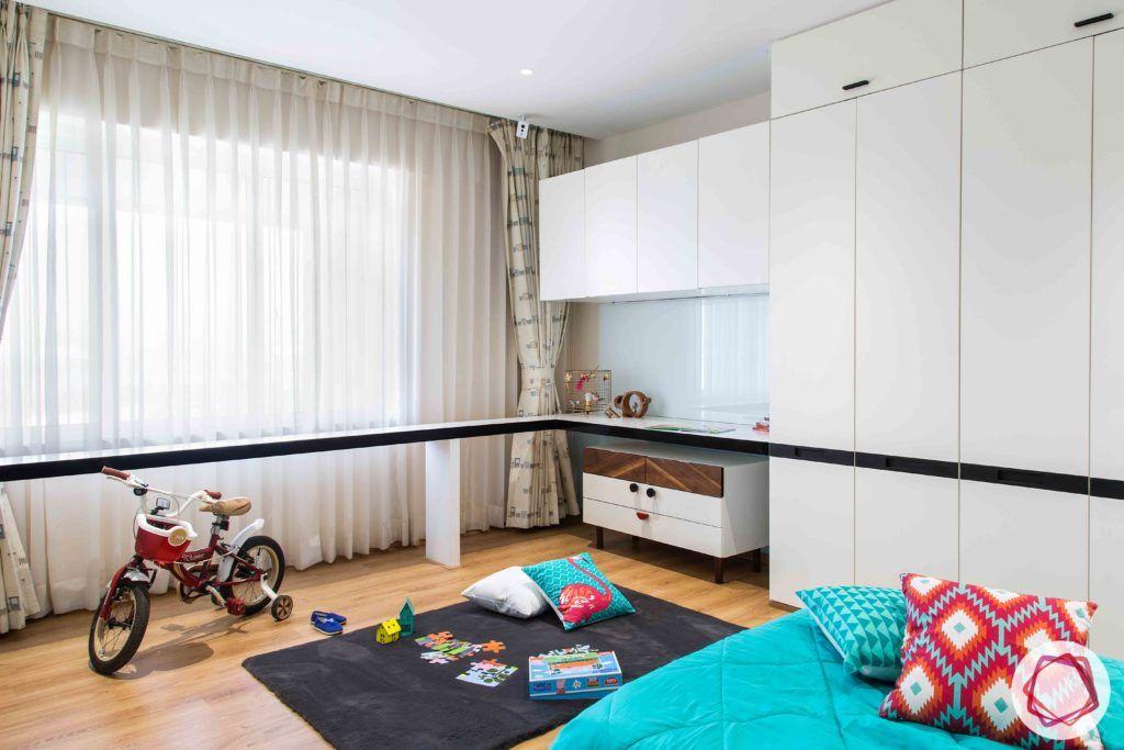 kids wardrobe designs-low drawers-wall ledge-white wardrobes