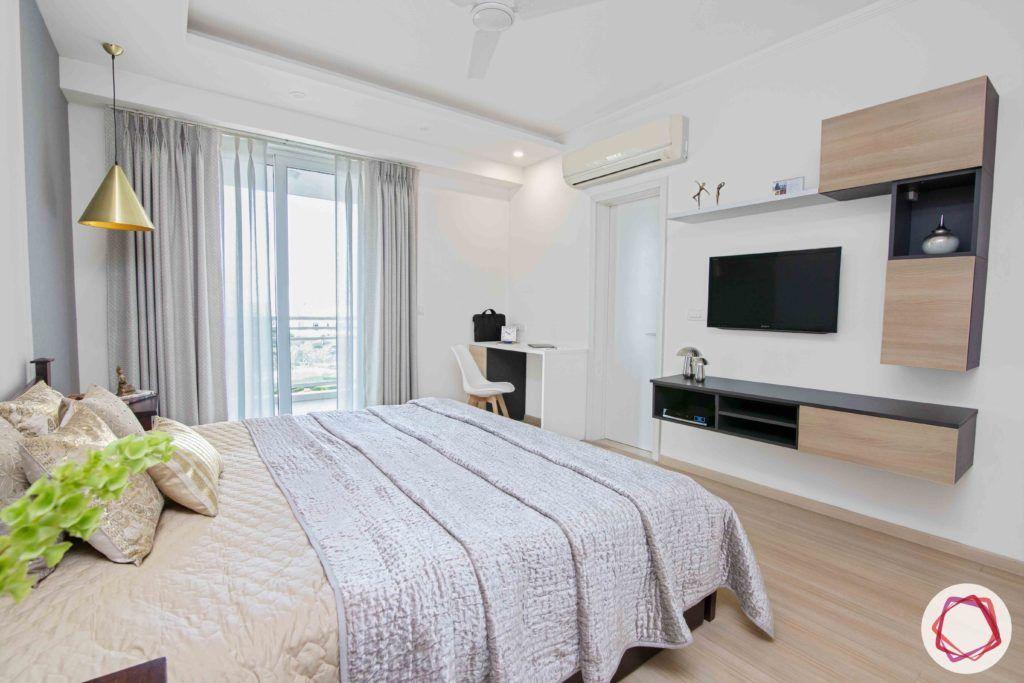 dlf gurgaon-wooden flooring designs-minimal tv unit designs