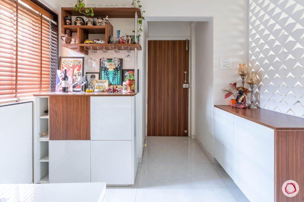 modern house images-foyer-jaali divider-laminate shoe rack-bar unit