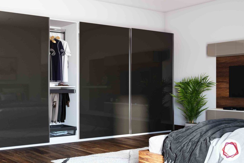 home-inspired-wardrobe-dark-glossy-clothes-potted-plant-bed