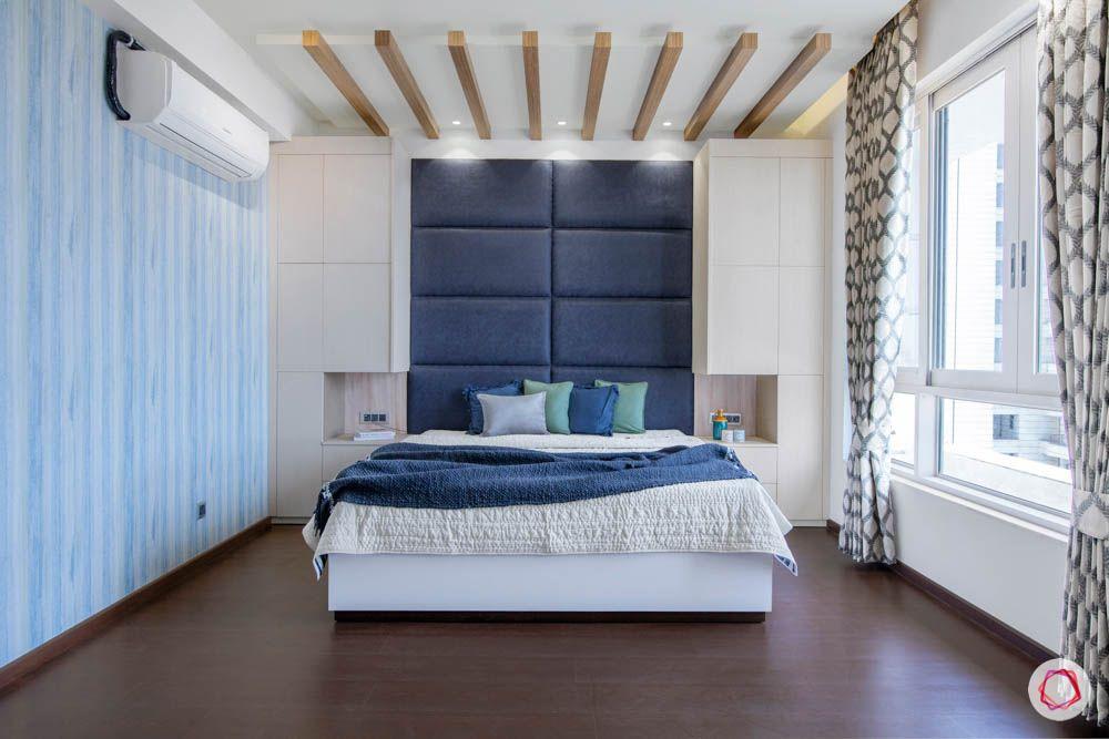 jaypee greens noida-wooden rafter designs-blue headboard designs