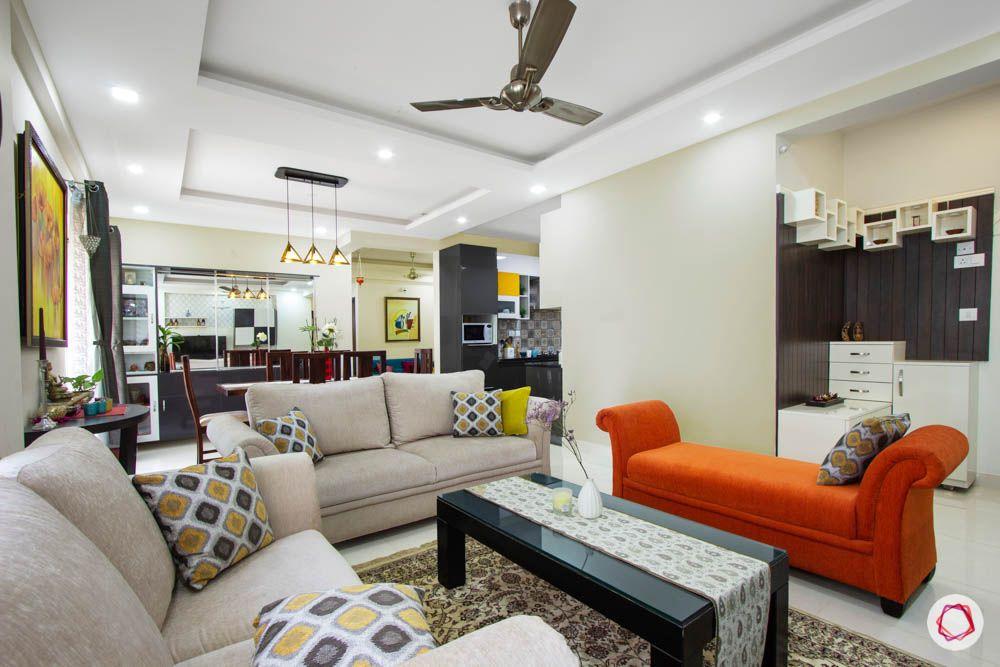 Vaswani Brentwood-living-room-sofas-orange-grey-throw-pillows-coffee-table
