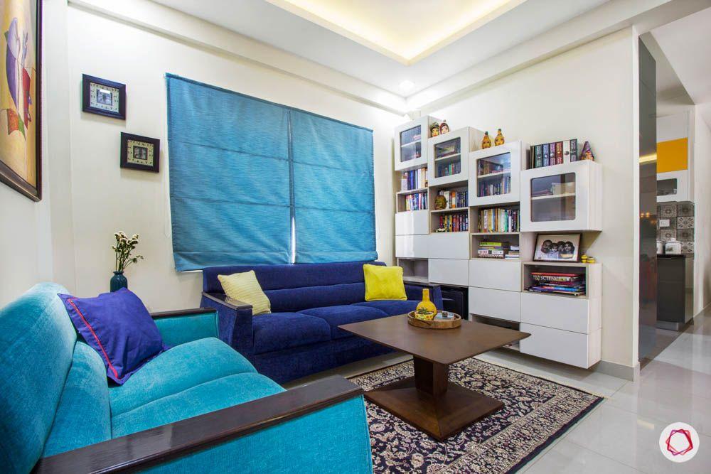 Vaswani Brentwood-entertainment-room-blue-shade-sofas-bookshelf
