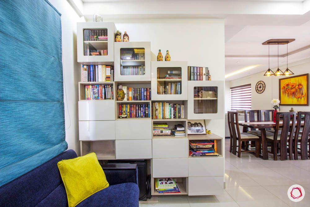 Vaswani Brentwood-entertainment-room-blue-shade-sofas-bookshelf-artefacts-pillows