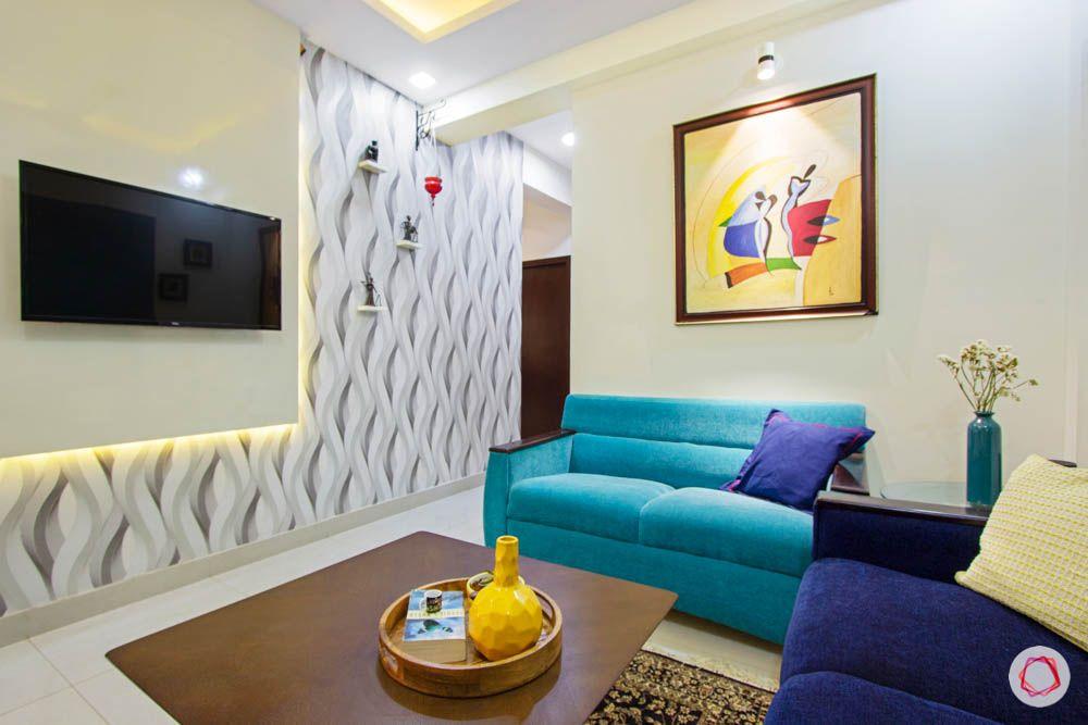 Vaswani Brentwood-entertainment-room-blue-shade-sofas-TV-unit-panel-painting