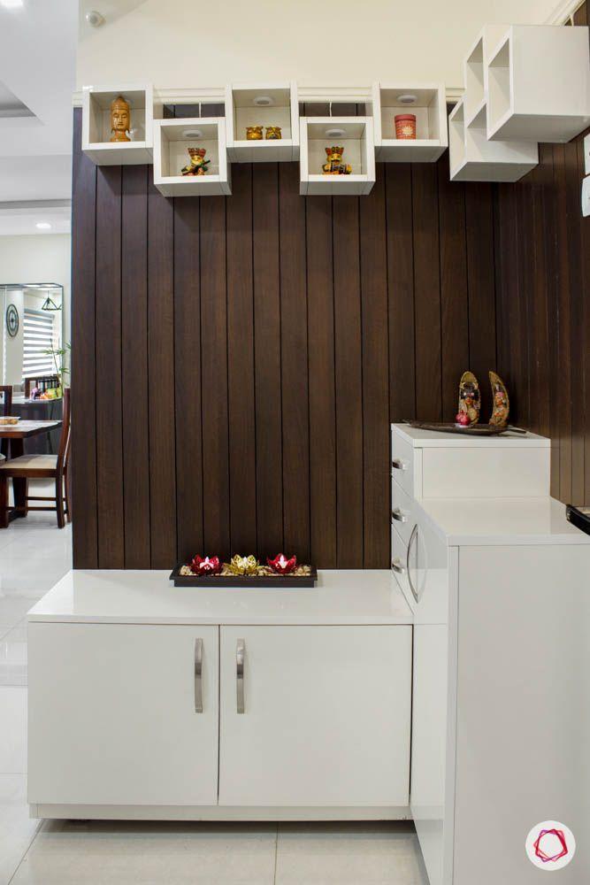 Vaswani Brentwood-foyer-shoe-cabinet-wood-wall-open-shelves-artefacts