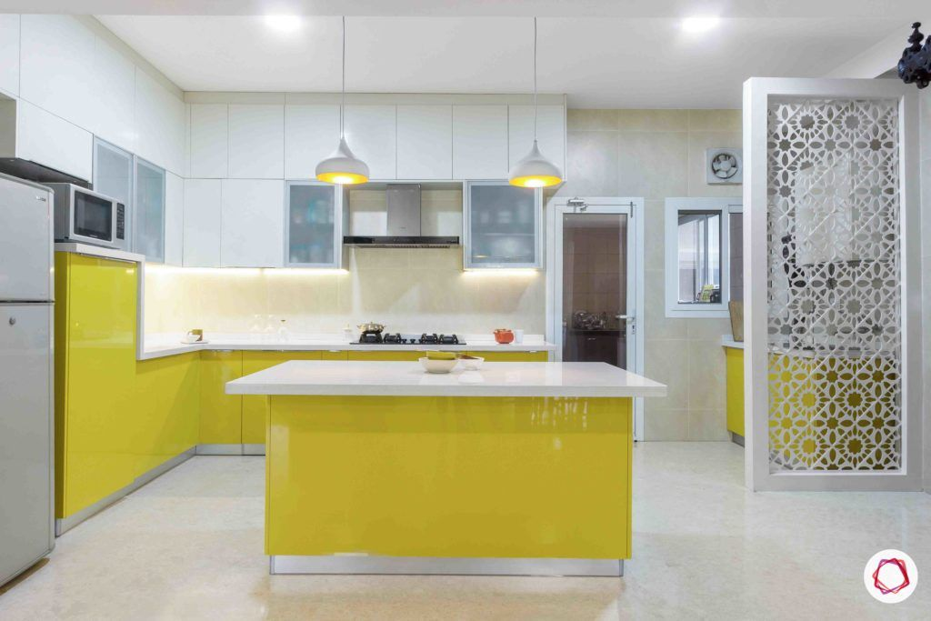 kitchen-yellow-white-lights-jali-cabinets-close-storage-frosted-glass-white-tiles