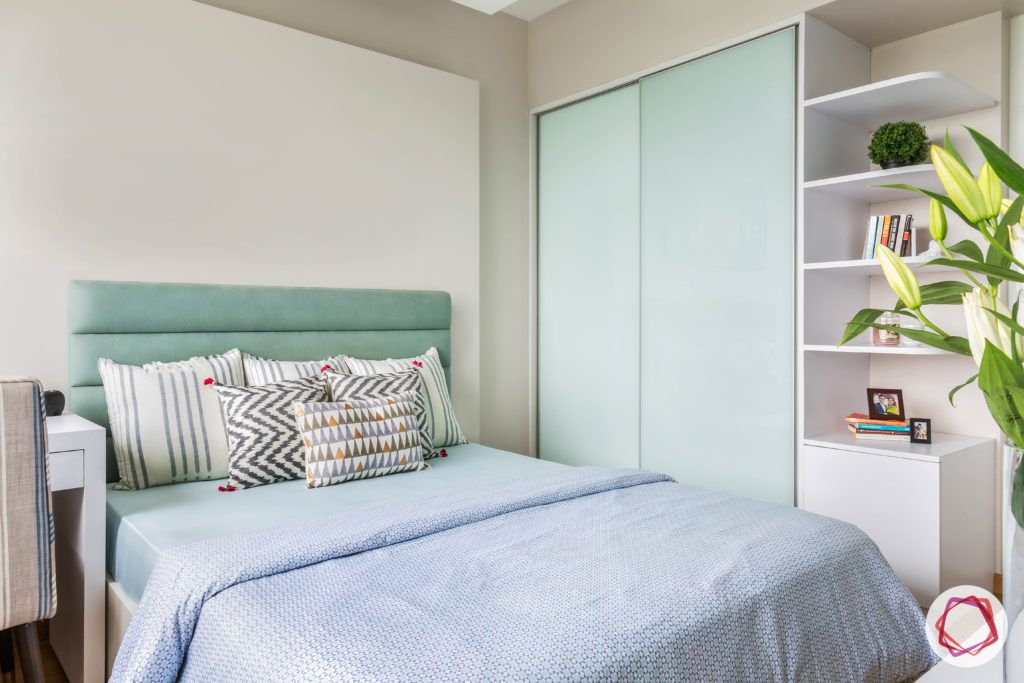 almirah designs for small rooms-backpainted glass wardrobe shutters-minimal wardrobe designs