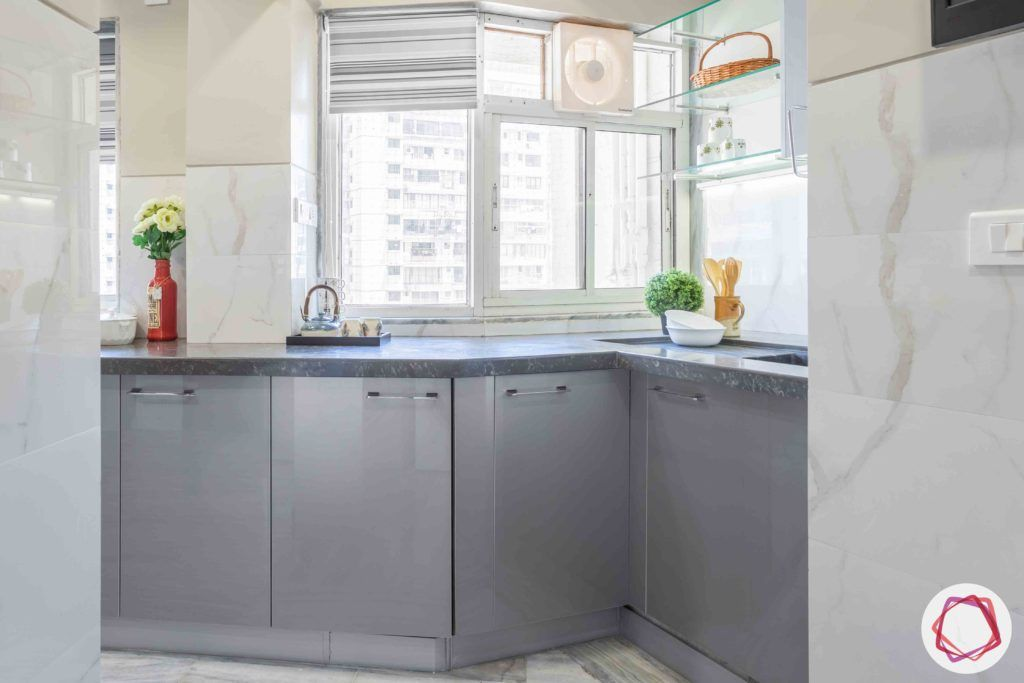 kitchen-base-grey-cabinets-window-plant-counter-pull-handles