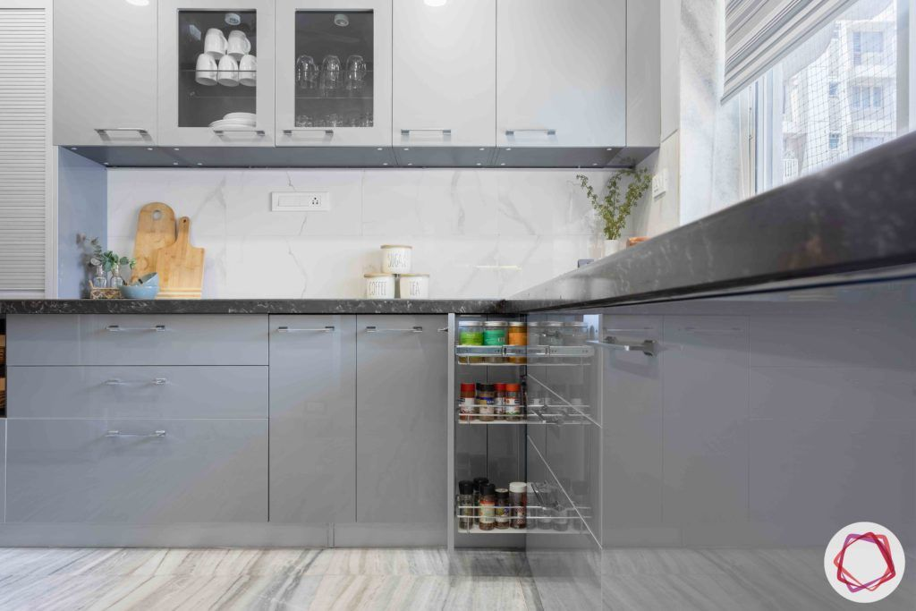kitchen-base-grey-cabinets-pull-out-tray-glass-shutter-window