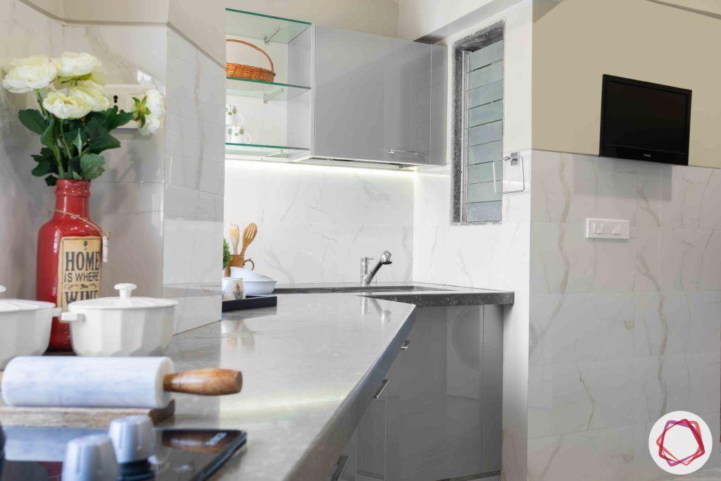 kitchen-base-grey-cabinets-glass-shelves-TV