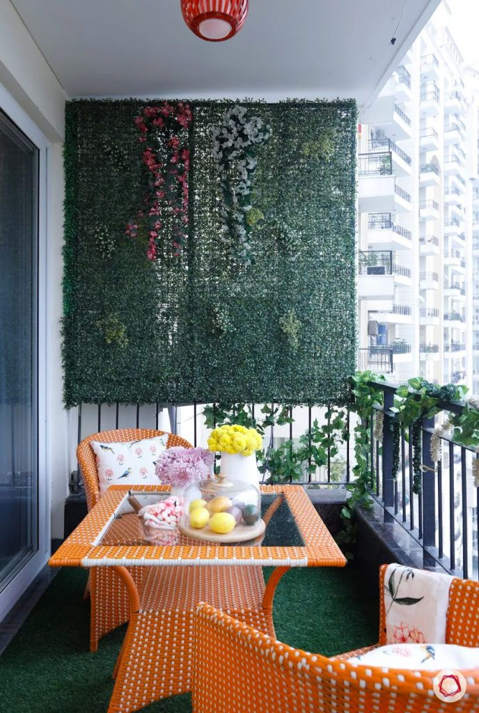 balcony garden-Orange furniture-yellow and pink flower pots