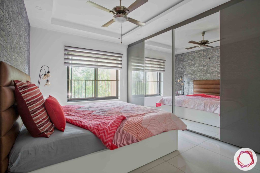 wardrobe-mirror-bedroom-sliding-grey-fan-pink-bedsheet