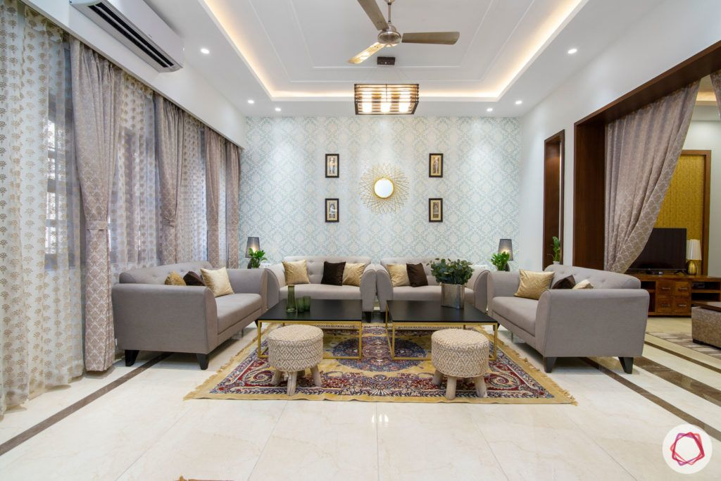 indian living room-gold ottomans-blue wallpaper