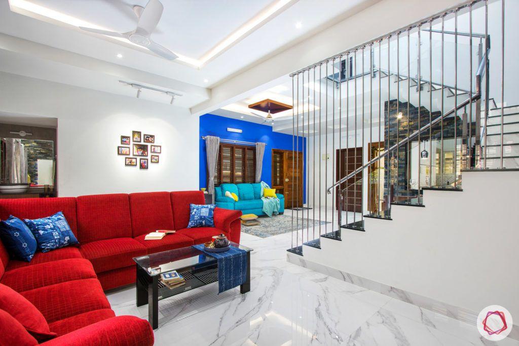 duplex house design-red sofa designs-blue wall ideas