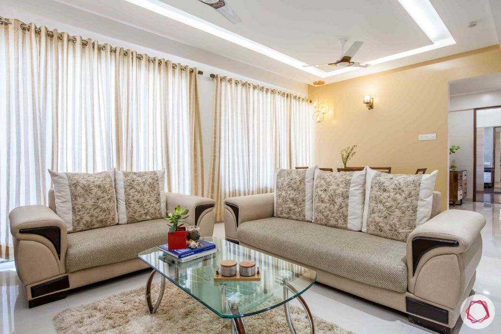 kunal-aspiree-living-room-curtains-centre-table