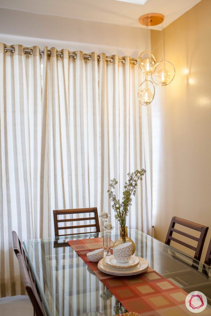 kunal-aspiree-dining-room-corner-lights-glass-top-table