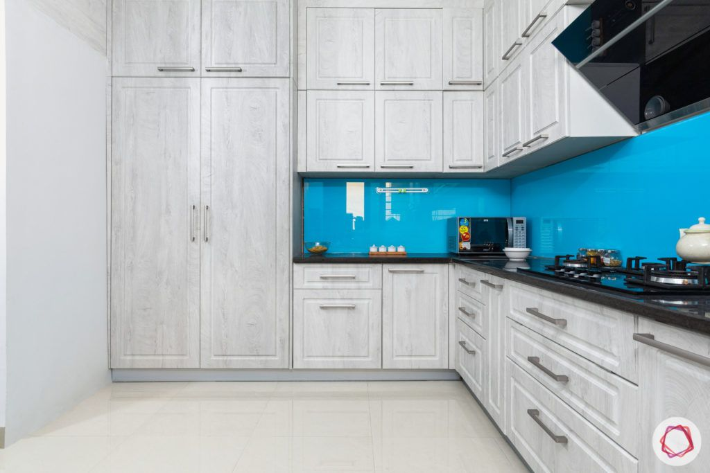 top 10 interior designers in Hyderabad-kitchen-cabinets-tall-units-white-wood