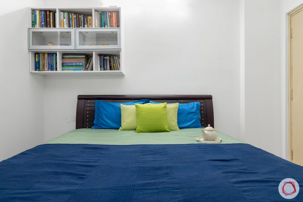 bedroom-blue-open-shelves-books-glass-shutter