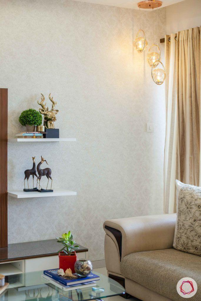 wall shelf design-white-wallpaper-pendant-lights-sofa-living-room