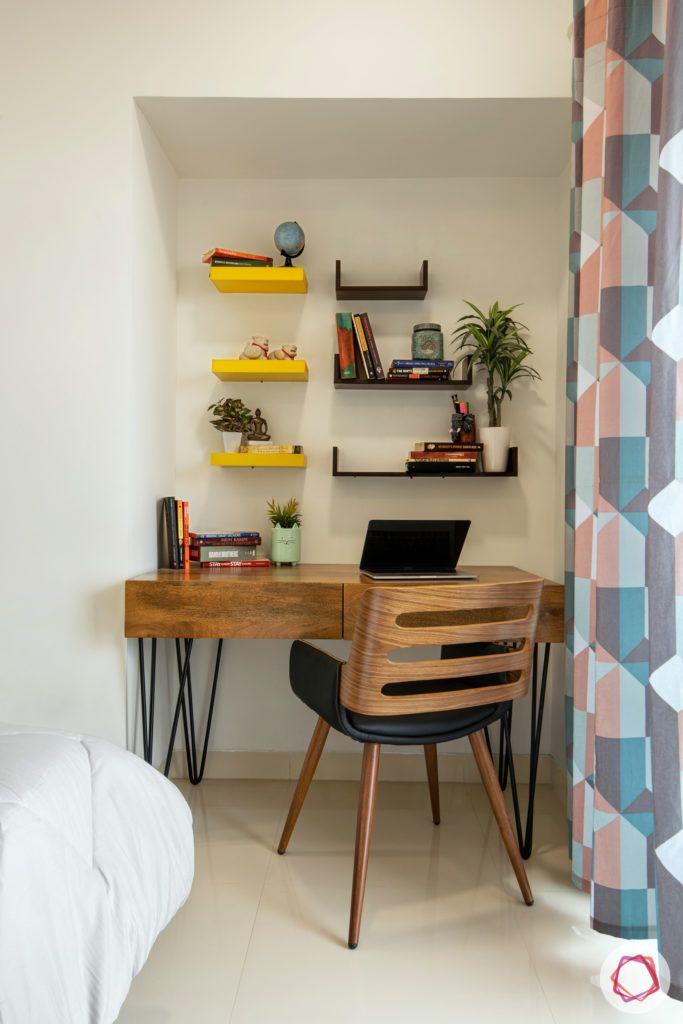 wall-shelf-design-yellow-black-bracket-plants-chair-table