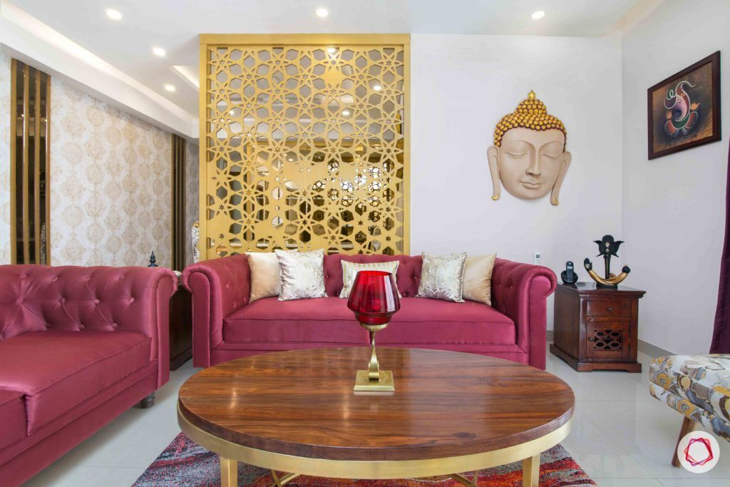 jali-design-living-room-red-sofa-coffee-table-buddha-art