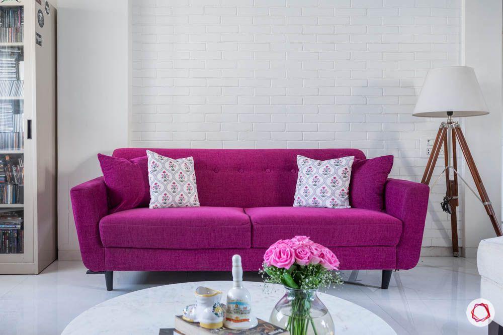 beautiful home images-living room-magenta sofa-tripod lamp-exposed brick wall