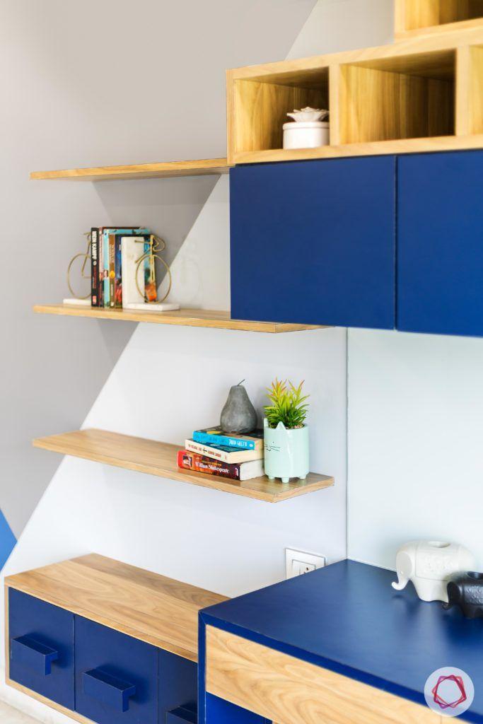 indian bedroom-wall ledges-display ledges-blue matte finish cabinets