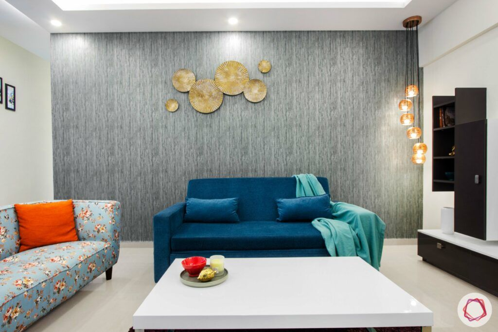 nitesh hyde park-blue sofa-pendant light-orange cushion
