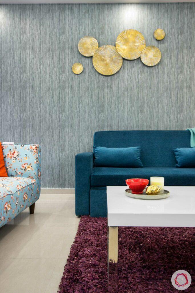 nitesh hyde park-blue sofa-blue wall-gold wall mount