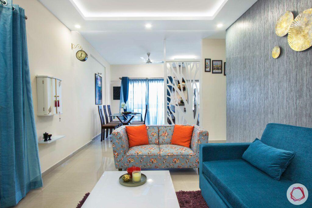 orange cushions-blue sofa
