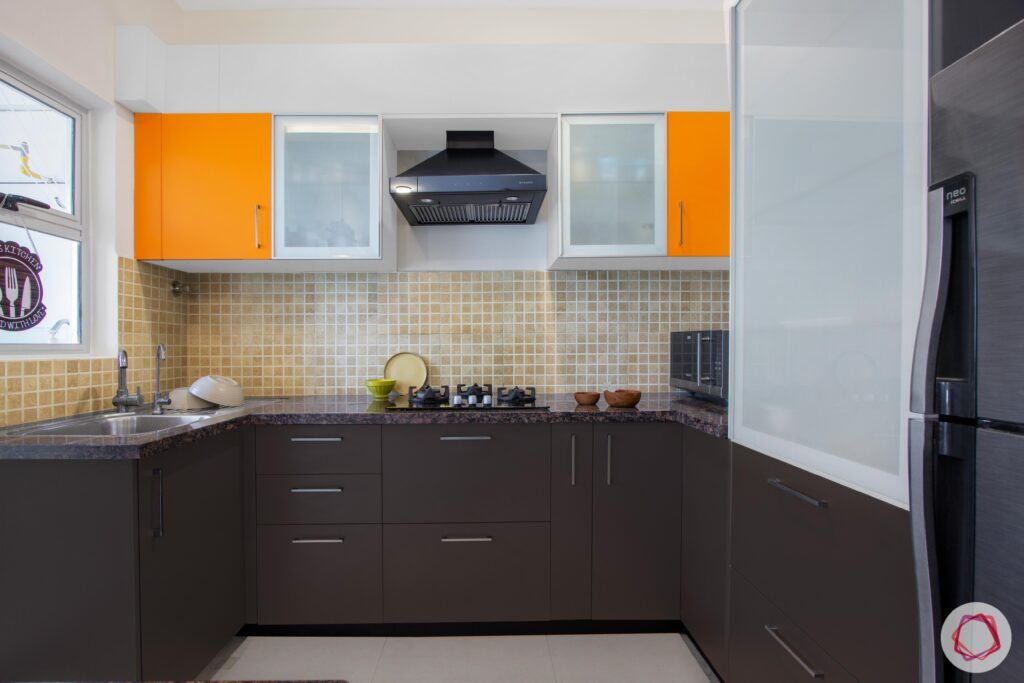 nitesh hyde park-orange cabinets-brown cabinets