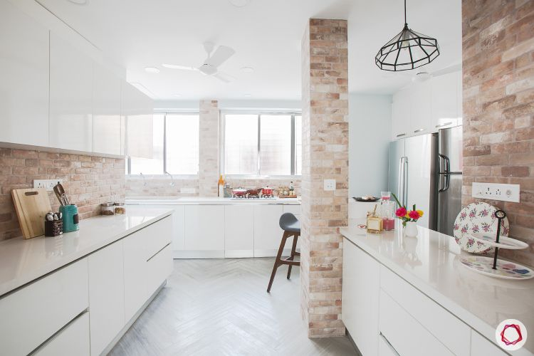 marble-design-kitchen-countertop-white-cabinets-exposed-brick