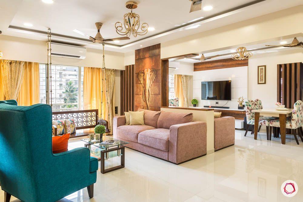 4 bhk flat in mumbai-pink sofa-living room-wooden swing-false ceiling