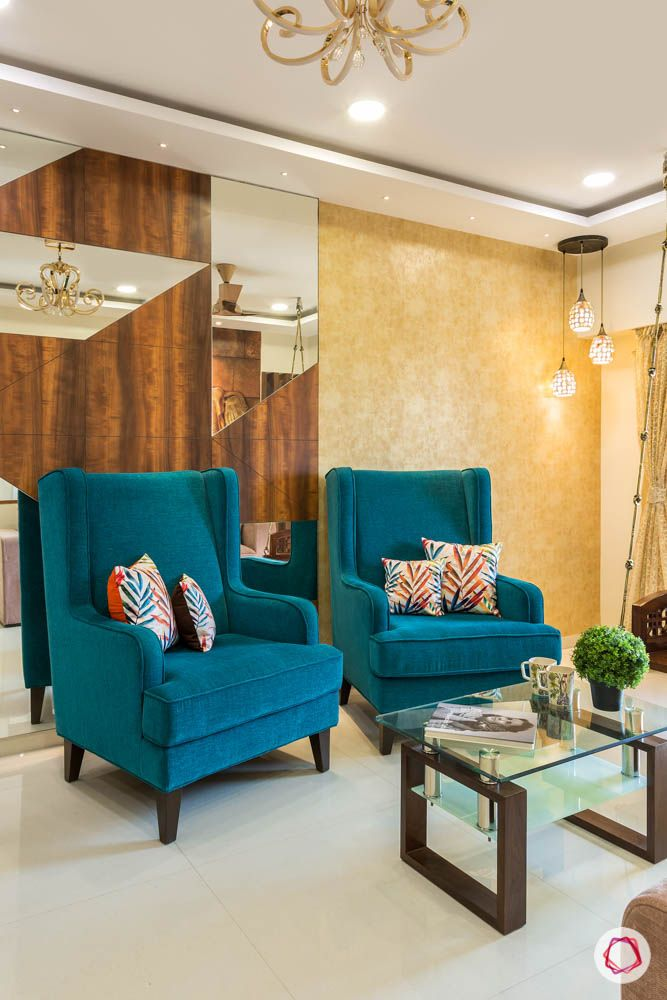 4 bhk flat in mumbai-blue high back chairs-textured wallpaper-corner lights