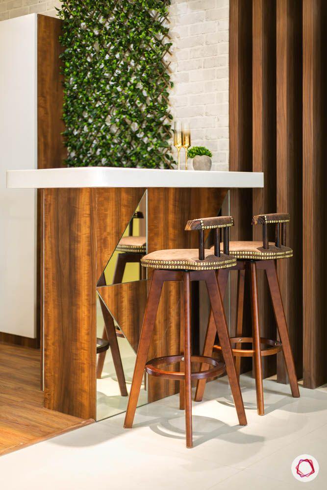 4 bhk flat in mumbai-breakfast counter-bar stools-exposed brick wall